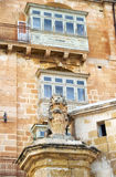An old house in Valletta. Malta. A view of old house with traditional Maltese style balcony and lion sculpture on the Lvant street of Valletta. Malta Royalty Free Stock Photography