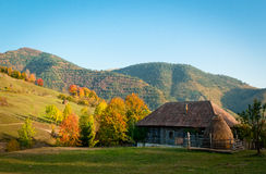 An old house in a very beautiful autumn rural landscape. A house in the hills of Romania Royalty Free Stock Images