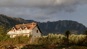 The old house with view on the mountains Royalty Free Stock Photo