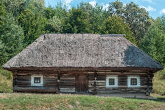 Old house in the village. Old wooden house in the village among the trees Stock Photography
