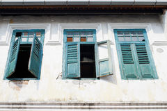 Old house wall with blue door and window. Royalty Free Stock Photo
