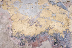 Old house wall with cracked plaster. Grunge textured background Royalty Free Stock Photography