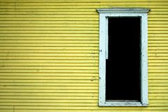 Old House Wall and Door. Old house with peeling paint and open door Stock Image
