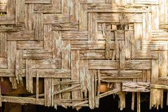 Old house wall made from pieces of bamboo stock photo