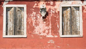 Old house wall, weathered wooden shutters Royalty Free Stock Photos