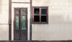 Old house wall with wooden door and window Stock Photos