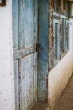 Old house wall with wooden door Royalty Free Stock Image