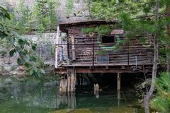 The old house of the watchman on stilts in the career of an old lens in the Sverdlovsk region royalty free stock image