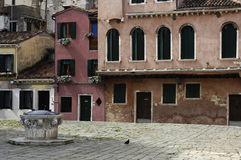 Old house and a well in Venice Royalty Free Stock Photos