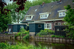 Old house which stands on the river. Old house with attic Windows which stands on the river Royalty Free Stock Images