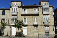 Old house with white iron galleries in a square. White windows and handrails. Pontevedra, old town, Galicia, Spain, sunny day. Pontevedra, Rias Baixas, Galicia royalty free stock photos