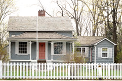 Old house with a white picket. Old Heritage House, with a white picket fence stock photo