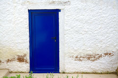 Old house white wall with new blue door Stock Photo