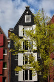 Old House with White Window Shutters in Amsterdam Stock Photo