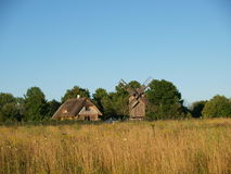 Old house and windmill Stock Photography
