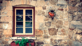 Old house window with flower pots in Hahndorf. Grungy look of old house wall with window and flower pots in the town of Hahndorf, Adelaide Hills area, South Royalty Free Stock Photos