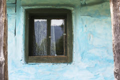 Old house window. Window of old house. wooden window frame green painted. dirty destroyed house detail Stock Image
