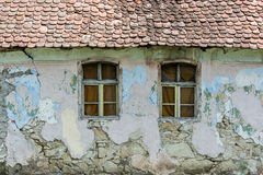 Old house windows. Two classic jalousie windows in old house wall Stock Photo