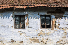 Old house windows. Two classic jalousie windows in old house wall Stock Image