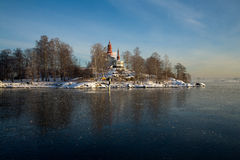 Old house in winter. An old house on the island of an ice covered water Royalty Free Stock Photos