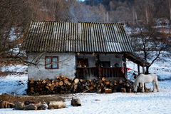 Old house in winter landscape Stock Images