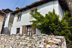 Old house and Wood centuries in village of Panagia, Thassos island, Greece Royalty Free Stock Image