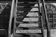 Old house and wood stairs. Black and white Royalty Free Stock Photo