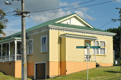 Old house with wooden cladding Stock Images