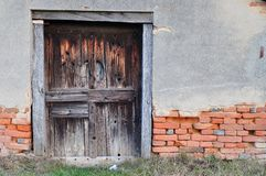 Old house with wooden door Stock Images