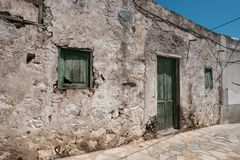 Old house with wooden door and weathered facade in rural villag. E stock images