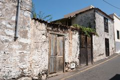 Old house with wooden door and weathered facade in rural villag. E royalty free stock photo