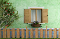 Old house with wooden fence and apple tree Stock Photo