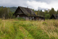 Old house in the woods Stock Photo