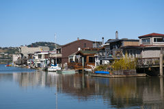 Old houseboats at a sunny summer day with blue sky. Some colourful obsolete house boats next to each other at a wonderful summer day Royalty Free Stock Images