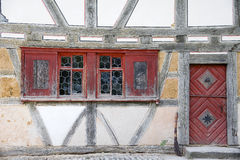 Old housefront with bulls-eye windows Stock Photography