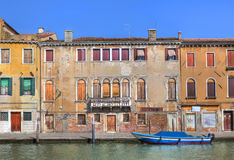 Old houses along canal in Venice, Italy. Stock Images