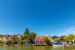 Old houses alongside the Dutch river Vecht Stock Images
