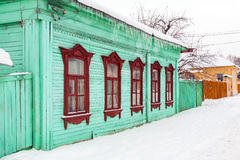 Old houses in ancient Russian city in winter overcast day Royalty Free Stock Photo