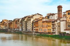 Old houses on the Arno River. And Ponte Vecchio in Florence, Italy royalty free stock photography