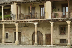 Old houses with balcony on pillars. Traditional stone houses at the Plaza Mayor (Main Square) of Pedraza village, Segovia, Spain stock photo