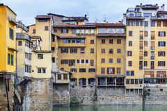 Old houses on the banks of the river Arno in Florence Stock Photos