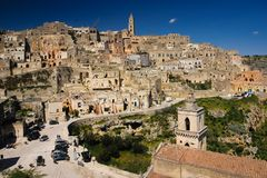 Old town. Matera. Basilicata. Apulia or Puglia. Italy. Old houses and bell tower of the Cathedral of Maria Santissima della Bruna and belfry of church San Pietro stock photos