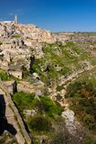 Old town. Matera. Basilicata. Apulia or Puglia. Italy. Old houses and bell tower of the Cathedral of Maria Santissima della Bruna and Gravina stream to the right royalty free stock image