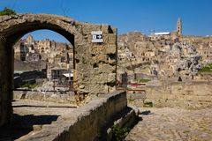 Old town. Matera. Basilicata. Apulia or Puglia. Italy. Old houses and bell tower of the Cathedral of Maria Santissima della Bruna. Matera. Basilicata. Apulia or stock photos