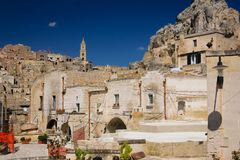 Old town. Matera. Basilicata. Apulia or Puglia. Italy. Old houses and bell tower of the Cathedral of Maria Santissima della Bruna, promontory of Idris to the stock photo