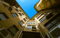The old houses and blue sky. The old houses with windows from the courtyard royalty free stock images