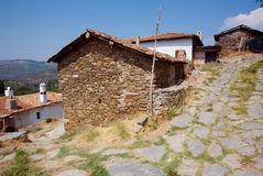 Old houses with brick walls in traditional turkish village with dirt street Stock Images