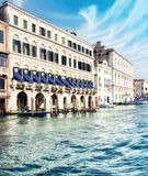 Old houses by Canal Grande in a summer day in Venice, Italy Stock Photos