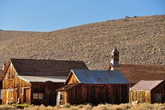 Old houses and church in Bodie State Historic Park. Bodie is a vey well preserved ghost town in California, USA Royalty Free Stock Photo