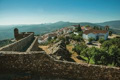Old houses and church on top of ridge with stone wall in Marvao. Old houses and church on top of ridge with stone wall and mountainous landscape, as seen from royalty free stock photography